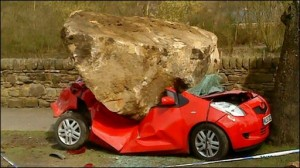Car smashed by rock