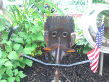 A discarded coal shovel makes a great flag holder and a charasmatic face.