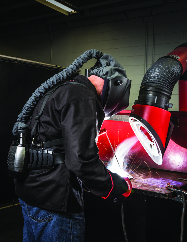 This welder uses both source capture as well as a personal air-filtration system.