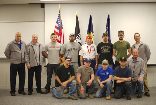 The first class of the Veterans Welding Program, including administrators, instructors, and students. Ernesto is kneeling second from the right. (1st Row) Chris Crump, Rocky Di Iacovo, Steve Coak, Nathan Kuharsky, Gene Szymaniak, Noble Smith, Charles Hill, Mike Kerr (2nd Row) Matt Zentz, Charles Carlin, Mike Rynicki, Ernesto Gomez, John McCollum