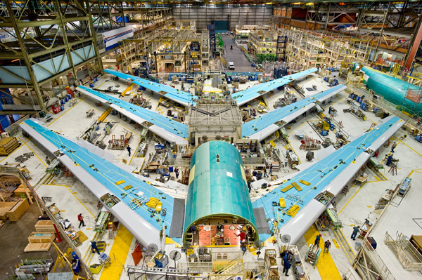 Boeing 747-8 assembly line. U.S. manufacturers are investing in advanced equipment, automation, and robotics in order to drive down the cost of production and compete in the global economy. Manufacturing operations using highly sophisticated new tools and new materials require highly trained workers capable of learning new skills.