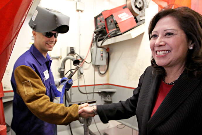 U.S. Secretary of Labor, Hild Solis, meets a member of Veterans in Piping program in 2011.