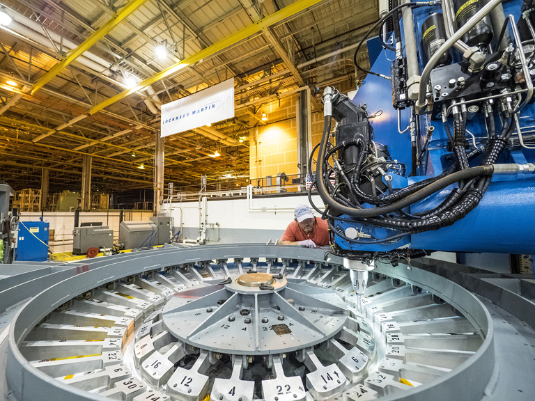 Friction-stir welding connects Orion spacecraft's tunnel and forward bulkhead.