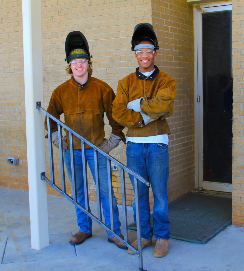 Students from Daniel Morgan Technology Center pose in front of a handrail they welded for a senior citizen.