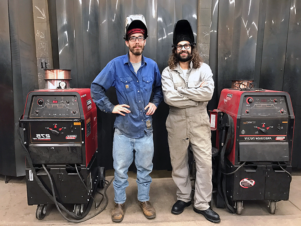 Welding instructor, Cody Stroud (left), with student, Patrick Camut