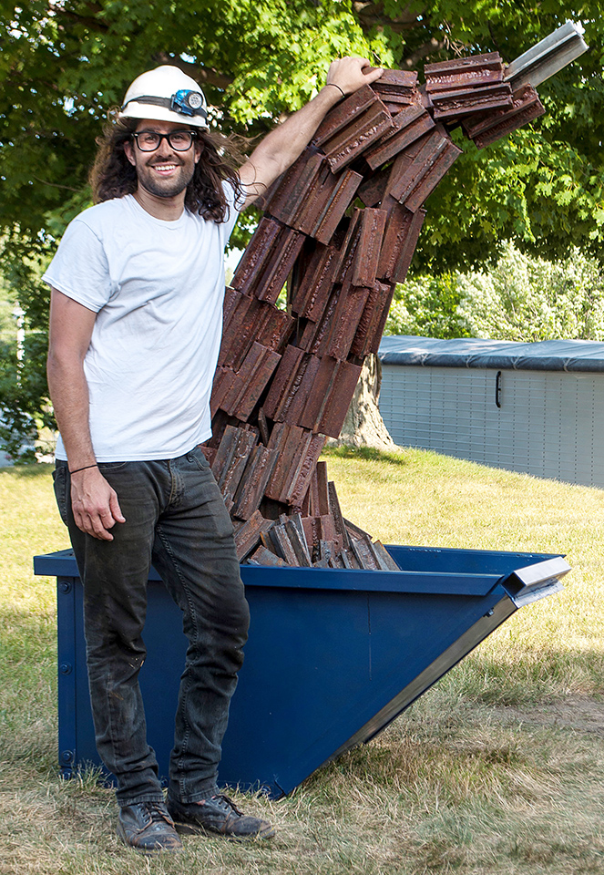 "Patruck Camut with sculpture, One Piece at a Time. ""I learned the basics of welding in art school and now I'm using welding school as a way to master what I love doing."" - Patrick Camut"