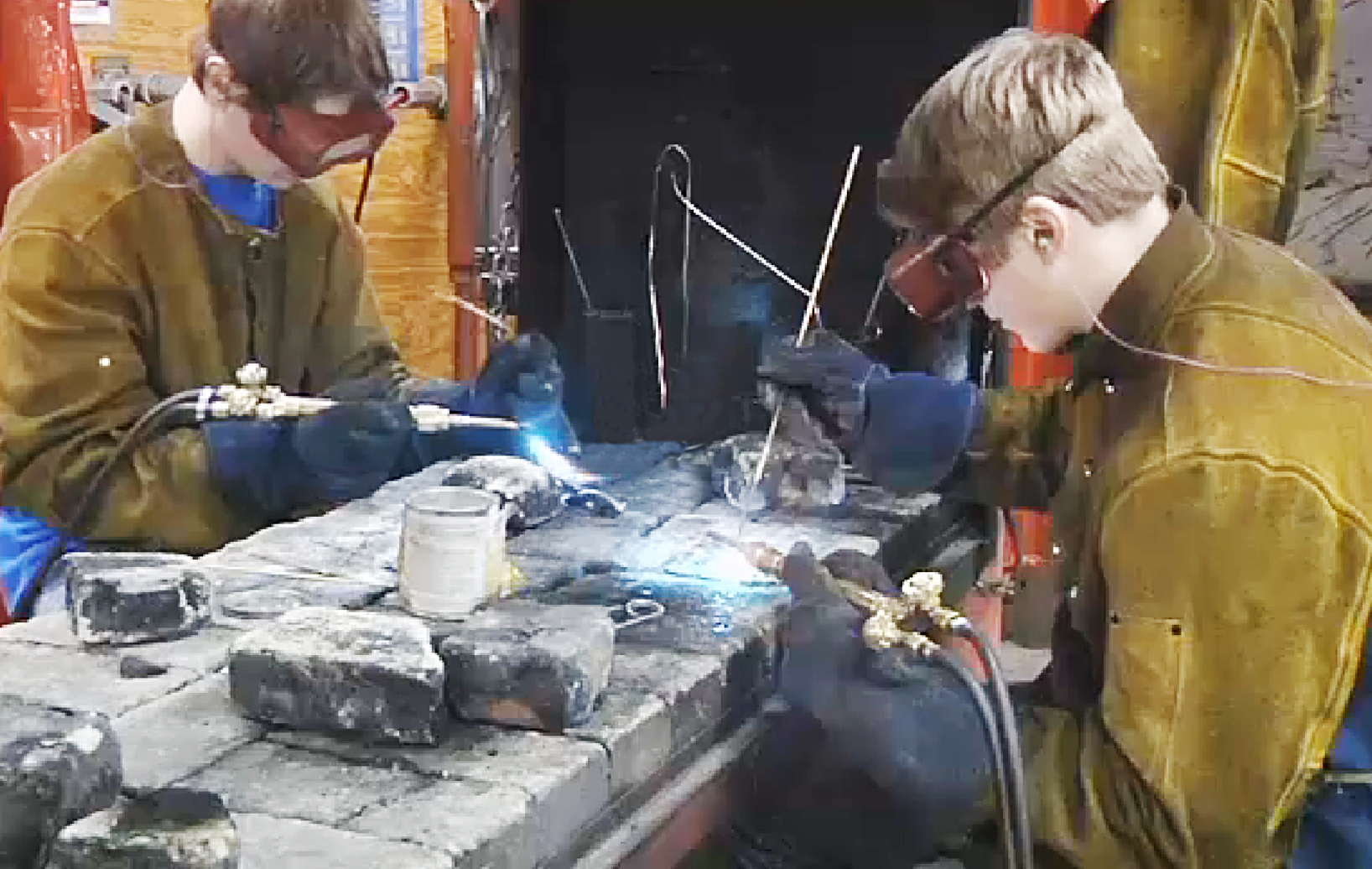 Butte High School students work on their fire pit project.
